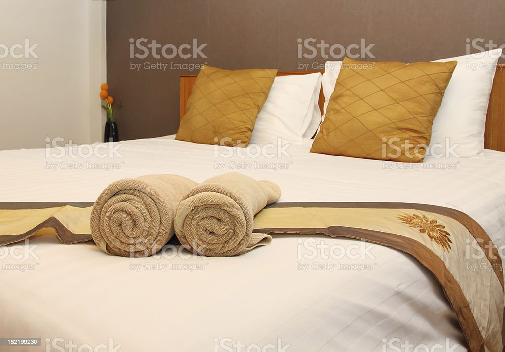 towel on the bed in luxurious hotel room stock photo