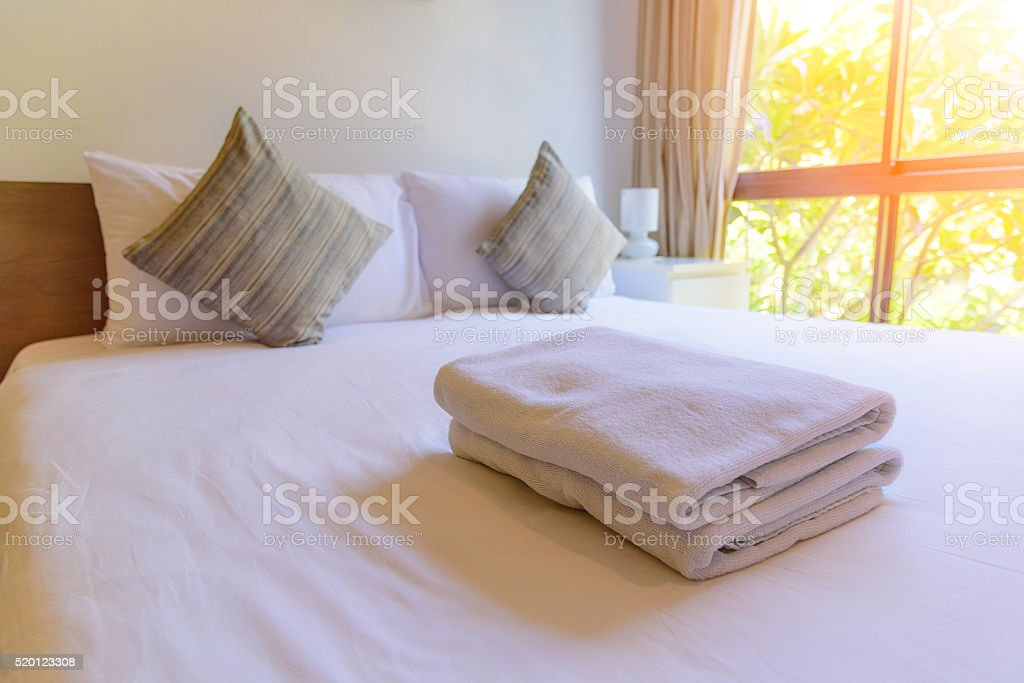 Towel on the bed stock photo