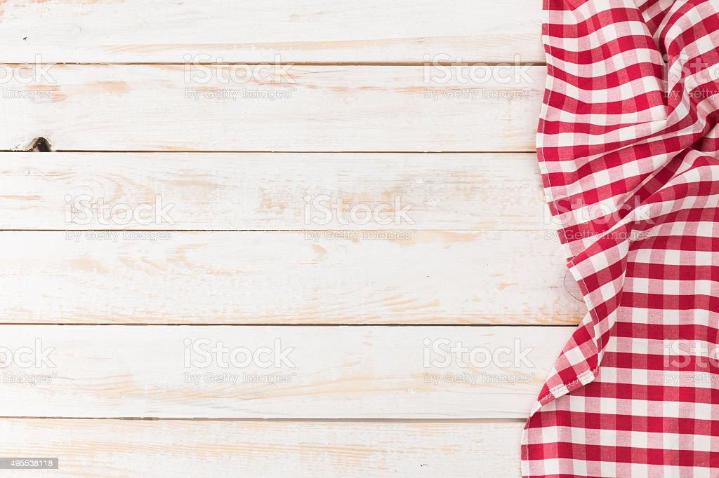 Towel over wooden kitchen table stock photo
