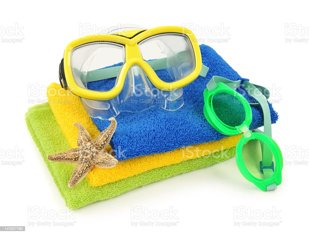 Towels and goggles with a starfish for a beach swim royalty-free stock photo