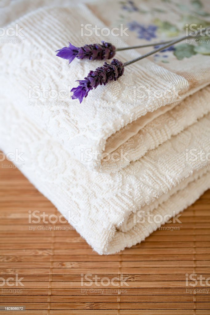 Towels and Lavender on bamboo royalty-free stock photo