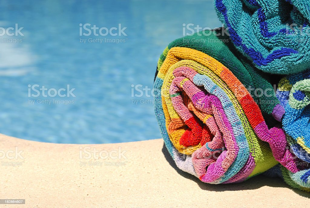 Towels by a Swimming Pool royalty-free stock photo
