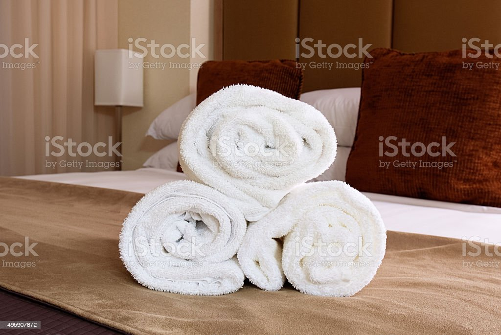 Towels on Bed in Hotel Room stock photo