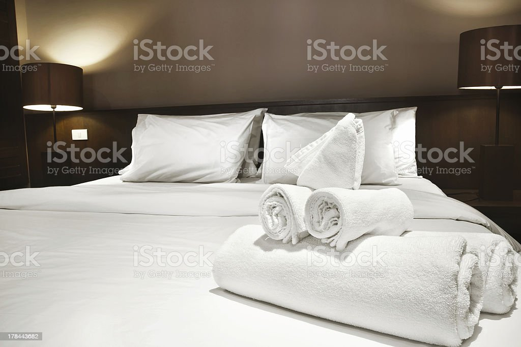 towels on bed stock photo