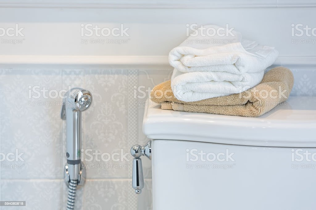 Towels on top of a toilet stock photo