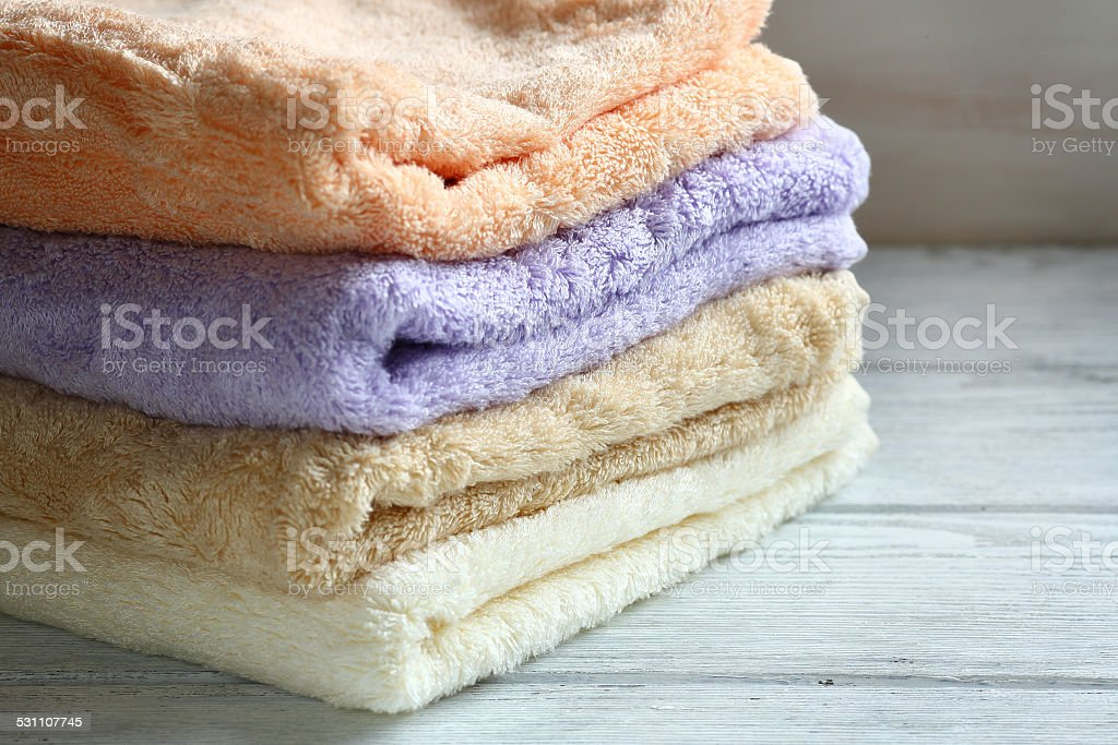 Towels on wooden boards stock photo