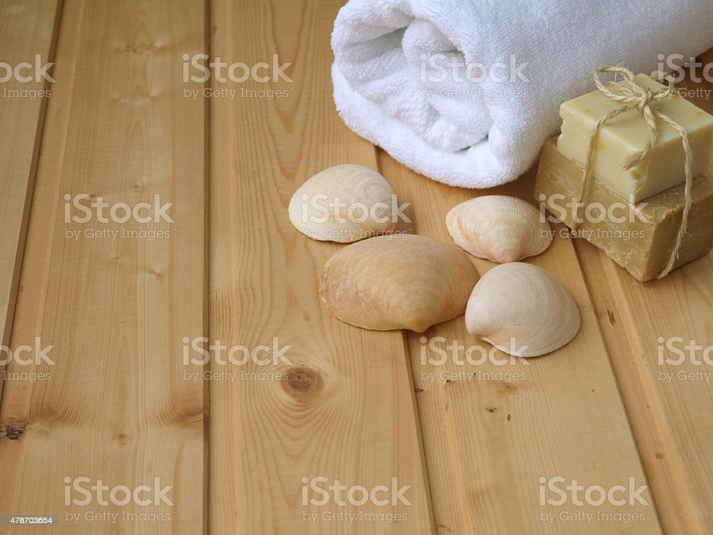 Towel,soap,and shells on the wooden background stock photo