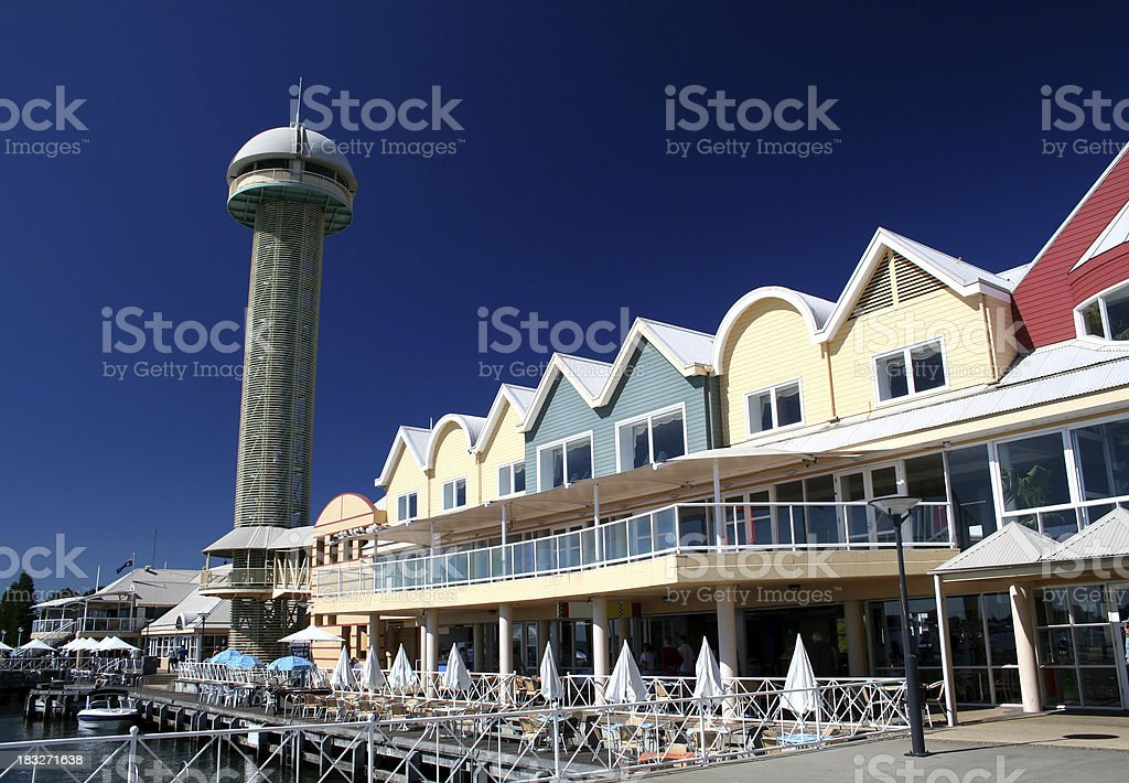Tower and buildings at a wharf stock photo