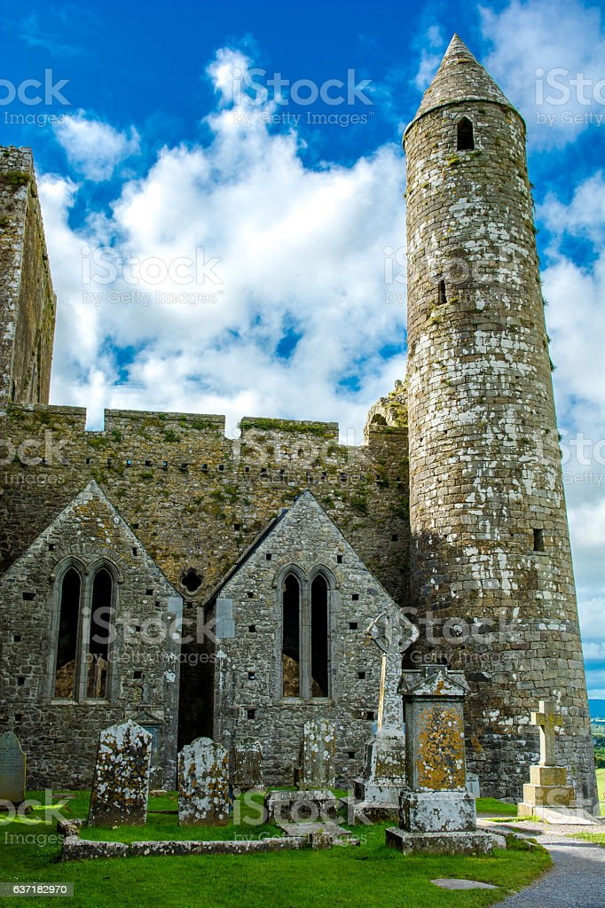 Tower and Graveyard at Rock of Cashel in Ireland stock photo