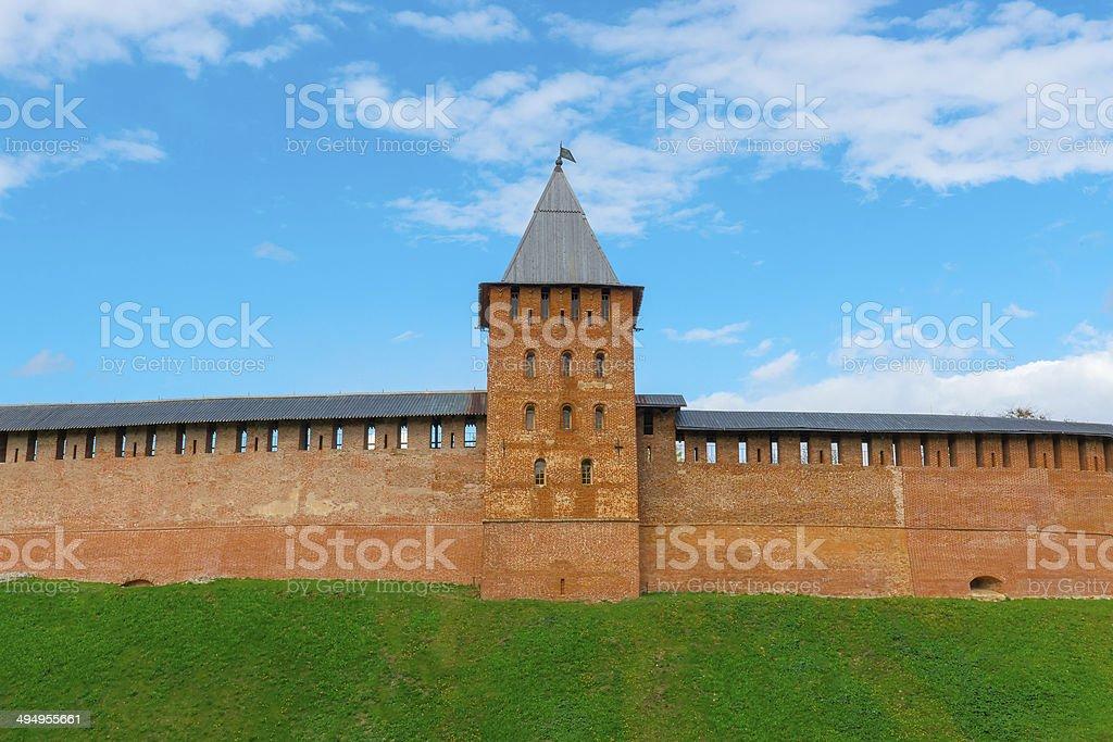 tower and wall of Novgorod Kremlin's redbrick royalty-free stock photo