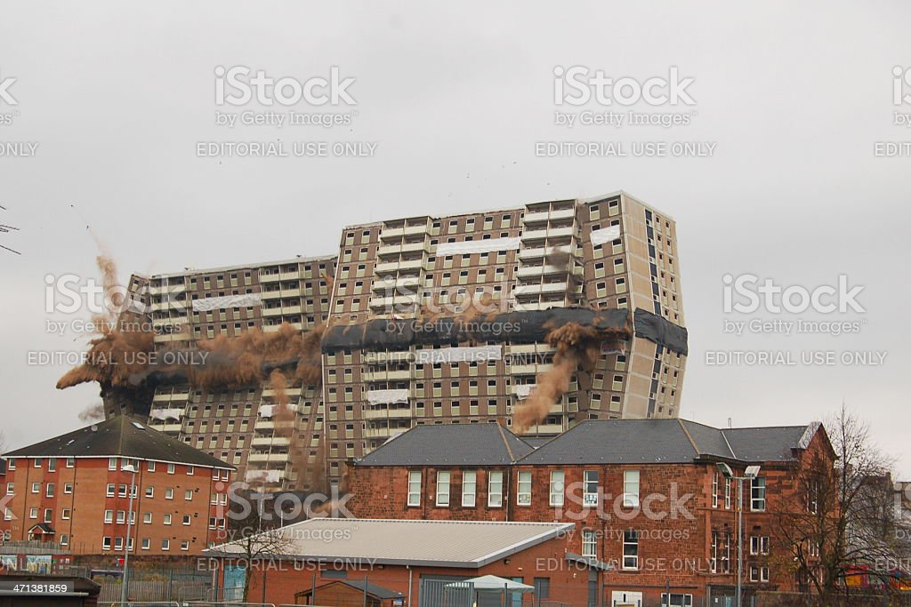 Tower block being demolished stock photo