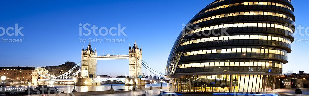 Tower Bridge and City Hall in London, England at dusk royalty-free stock photo
