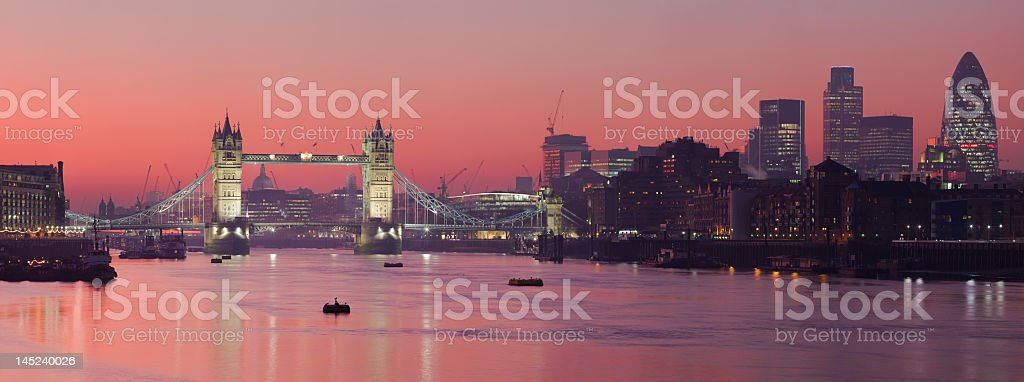 Tower Bridge and city of London with deep red sunset stock photo