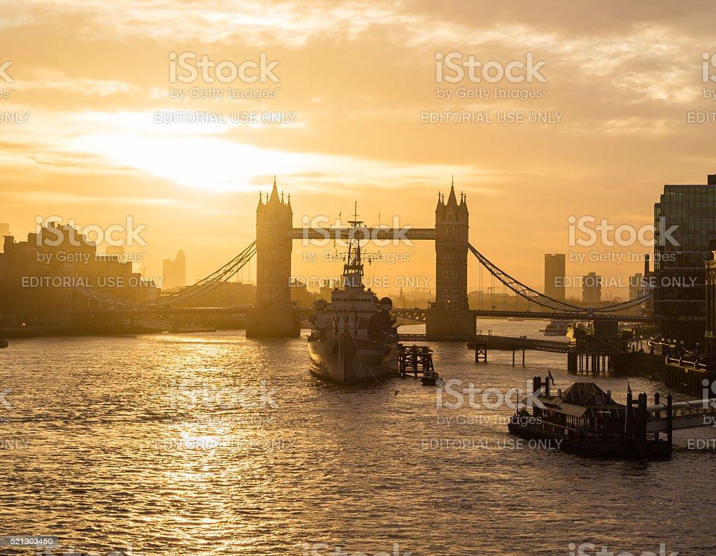 Tower Bridge and HMS Belfast in London at sunrise stock photo