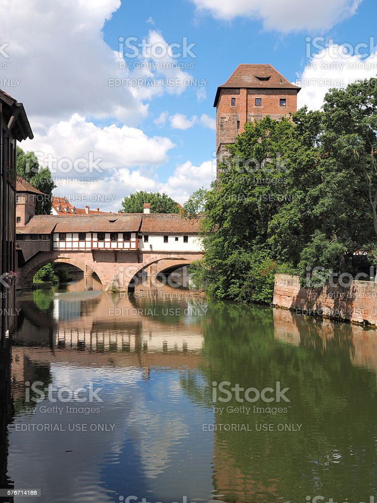 Tower, bridge and old houses with the Pegnitz river stock photo