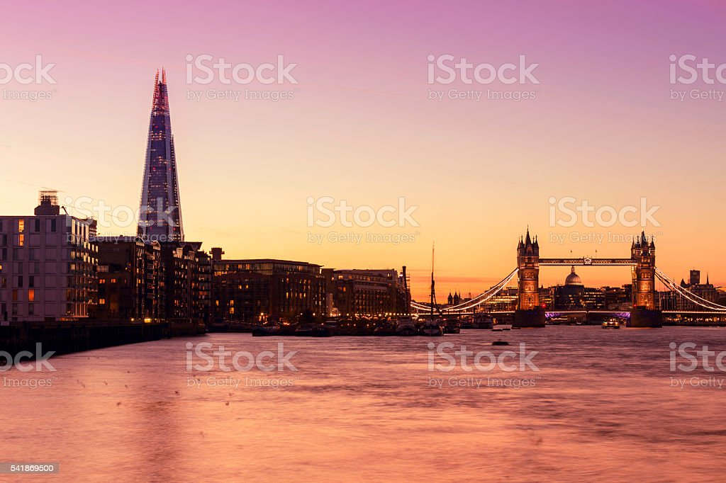 Tower Bridge and The Shard in London at twilight stock photo