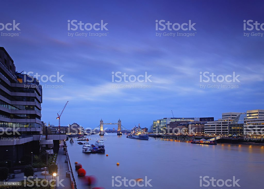 Tower Bridge and the Thames river at dusk royalty-free stock photo