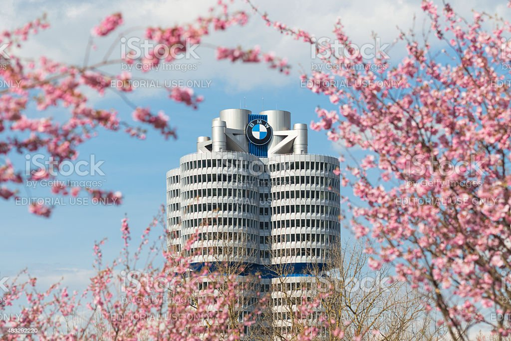 Tower building BMW head office framed pink spring flowering bran stock photo