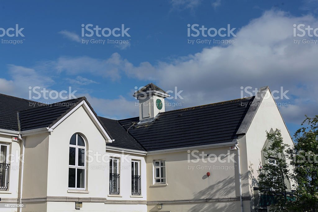 Tower clock on the roof of a store royalty-free stock photo