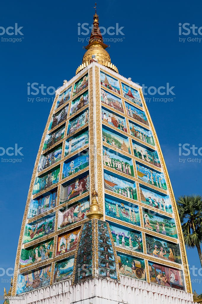 Tower depicting the life of Buddha stock photo