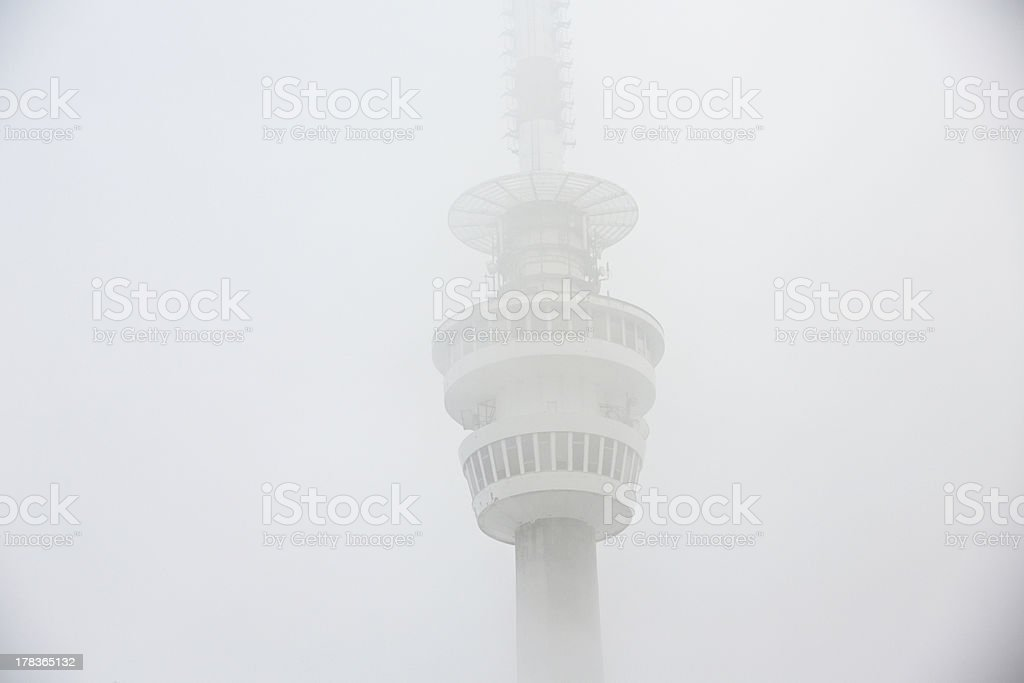 Tower in mystery fog stock photo