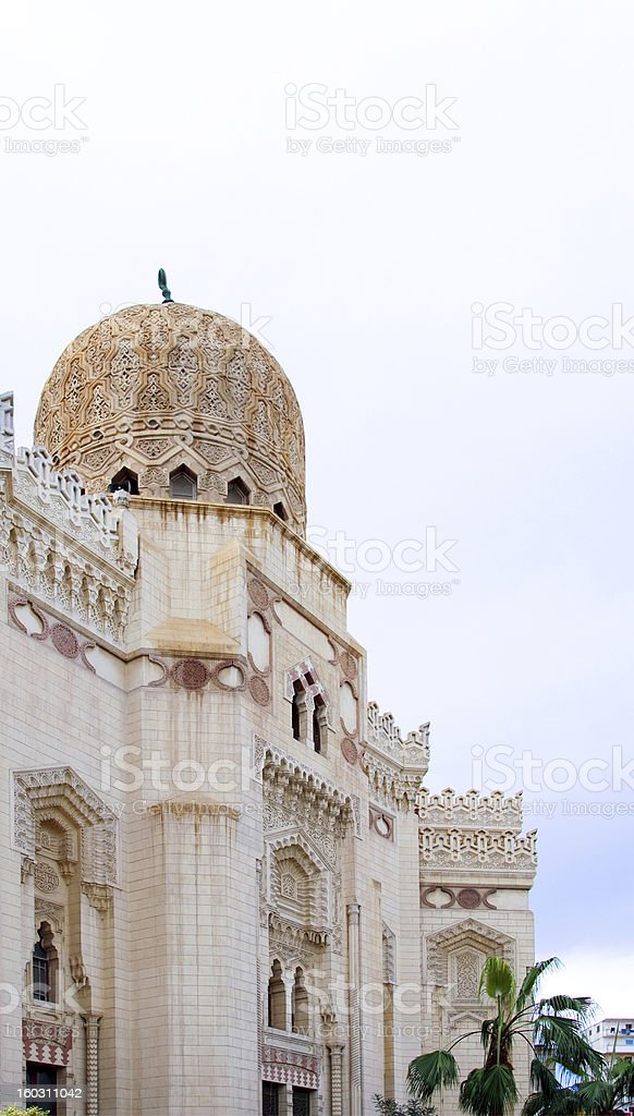 Tower minaret against a bright blue sky, Alexandria, Egypt royalty-free stock photo