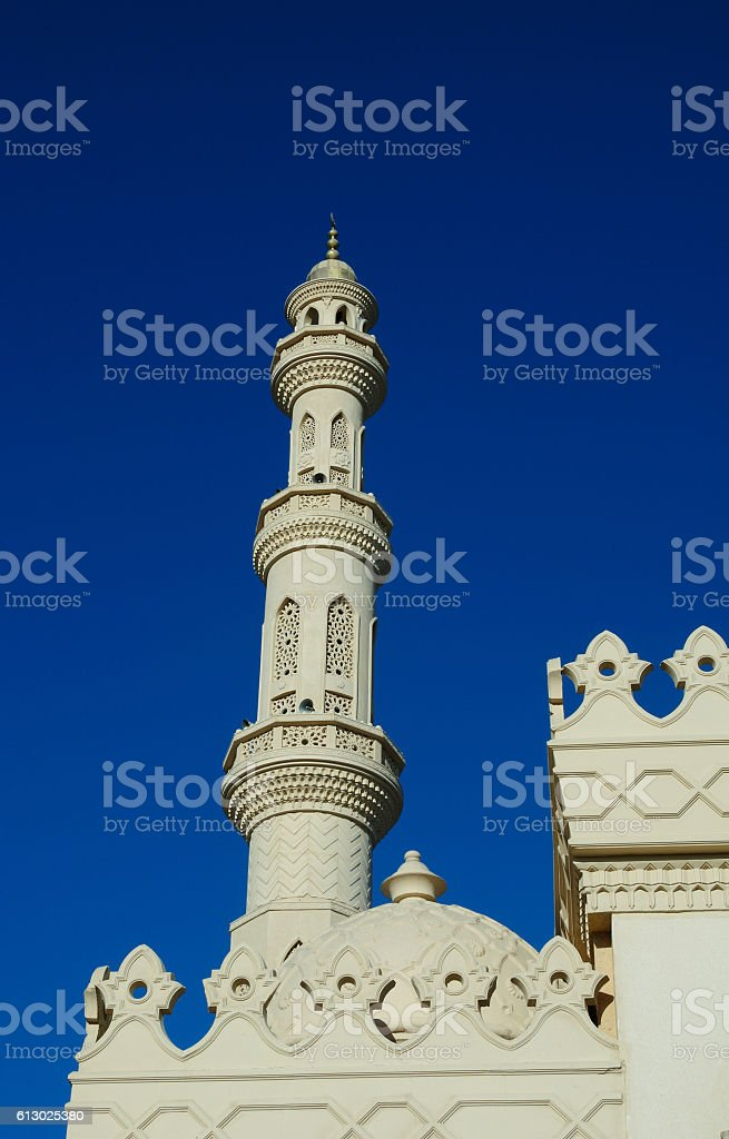 Tower minaret against a bright blue sky, Alexandria, Egypt stock photo