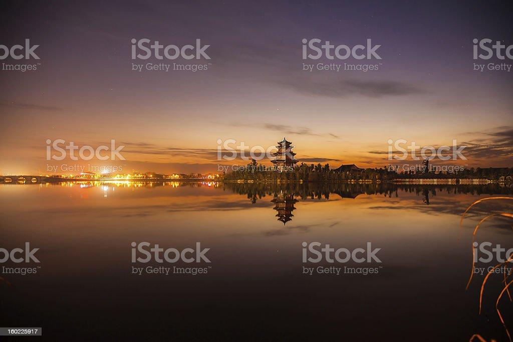 tower near lake at night royalty-free stock photo