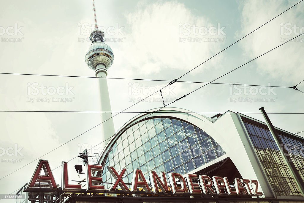 Tower next to sign of Alexanderplatz in Berlin, Germany stock photo