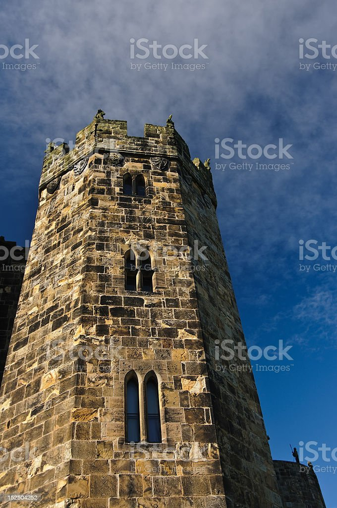 Tower of Alnwick Castle against the blue sky royalty-free stock photo