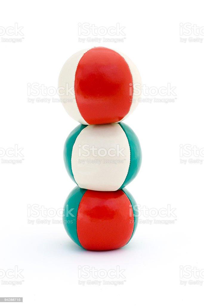 Tower of balancing juggling balls stock photo