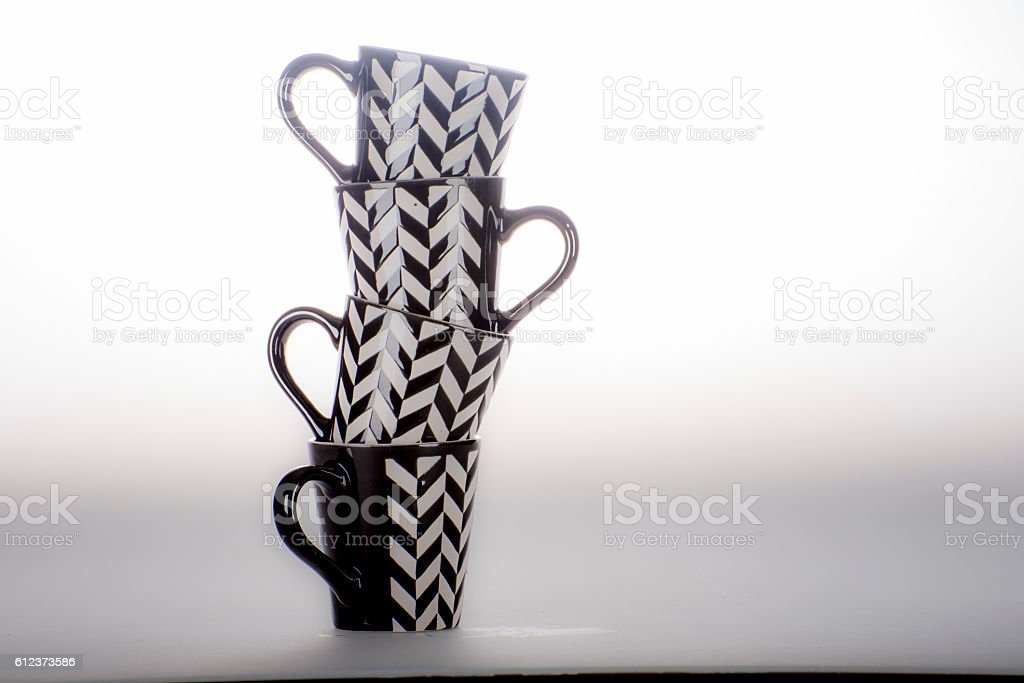 Tower of black and white demitasse coffee cups. stock photo