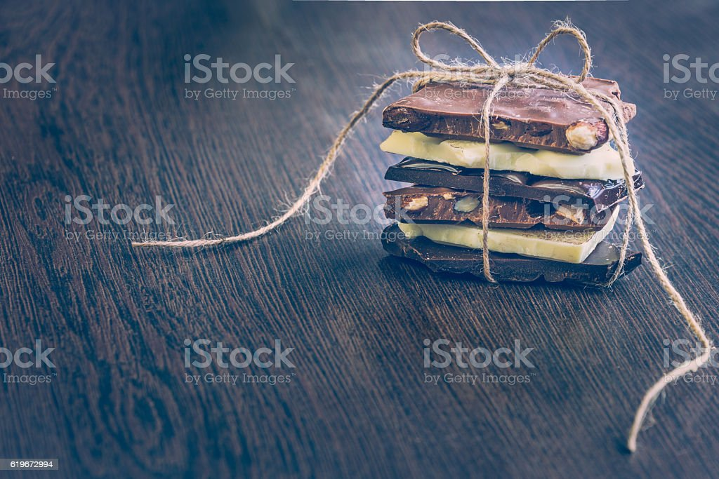 Tower of chocolate bars wrapped like a chocolate present. stock photo