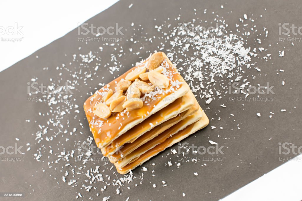 Tower of cookies with caramel, mani and grated coconut. stock photo