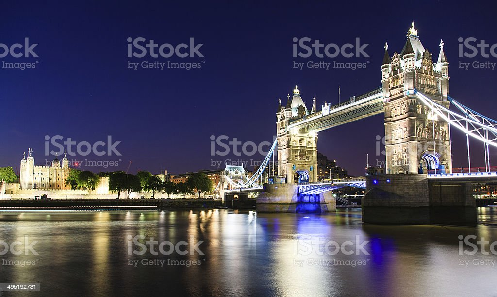 Tower of London and Tower Bridge illuminated at night stock photo