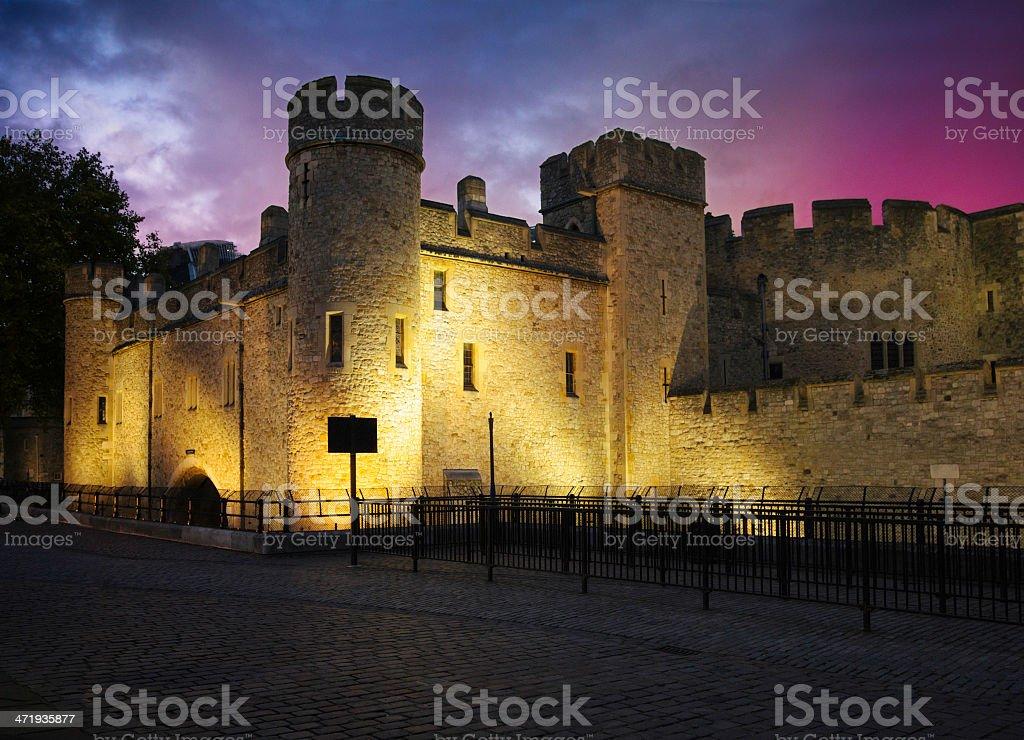 Tower of London defensive walls illuminated at dusk stock photo