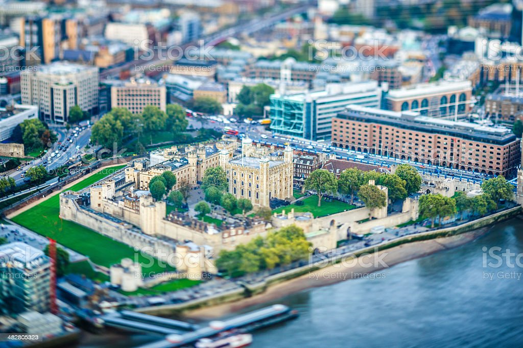 Tower of London next to river Thames at dusk stock photo