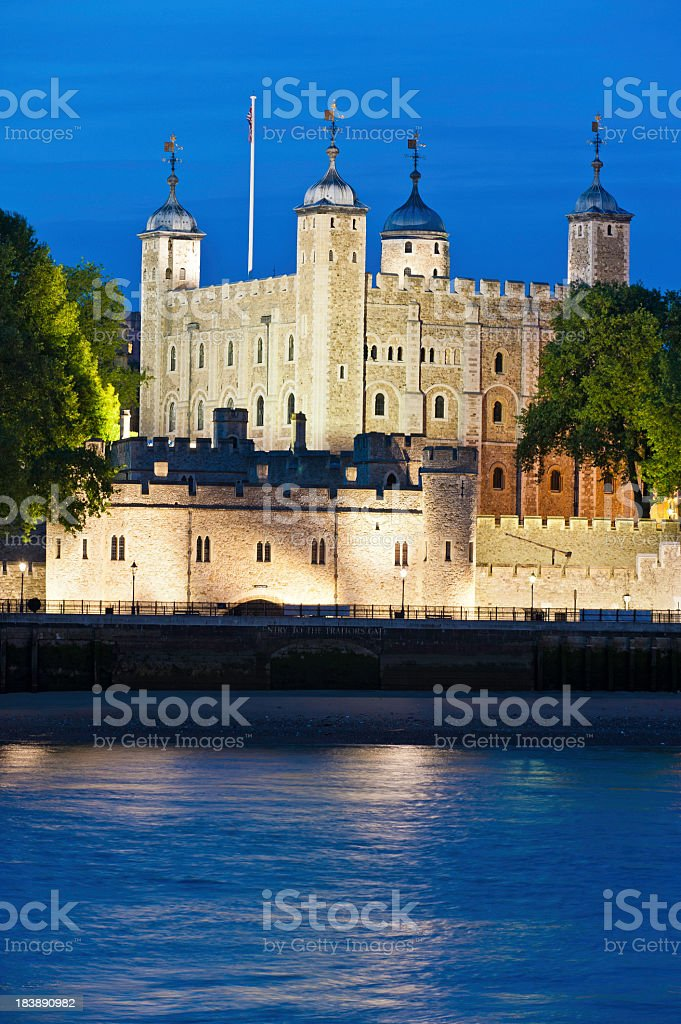 Tower of London spotlit at night over River Thames stock photo