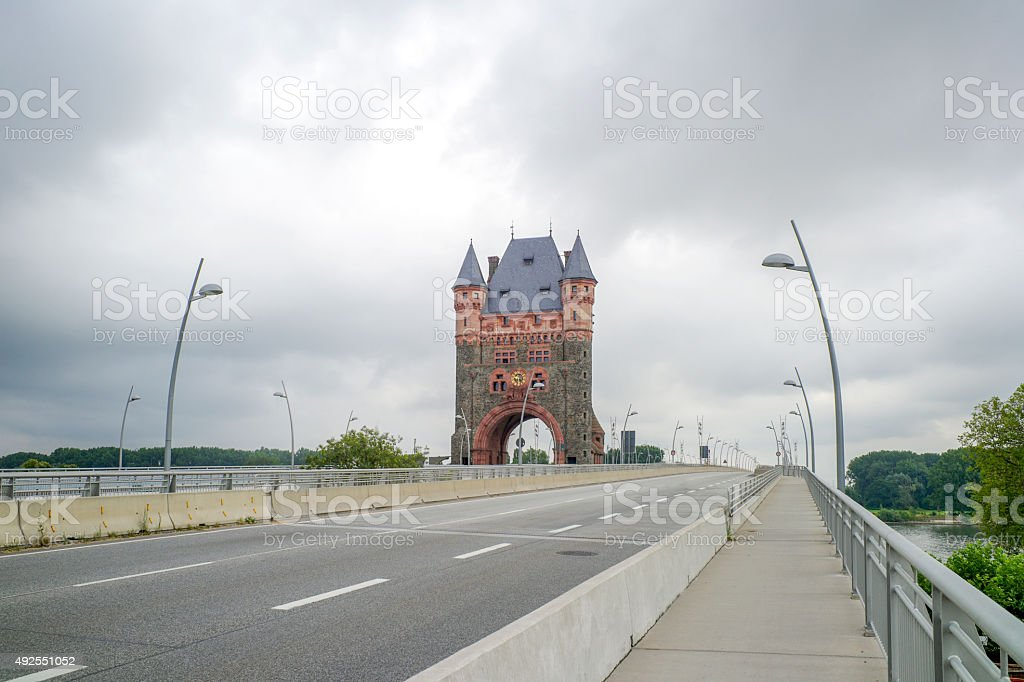 Tower of old bridge in worms over rhein river germany stock photo