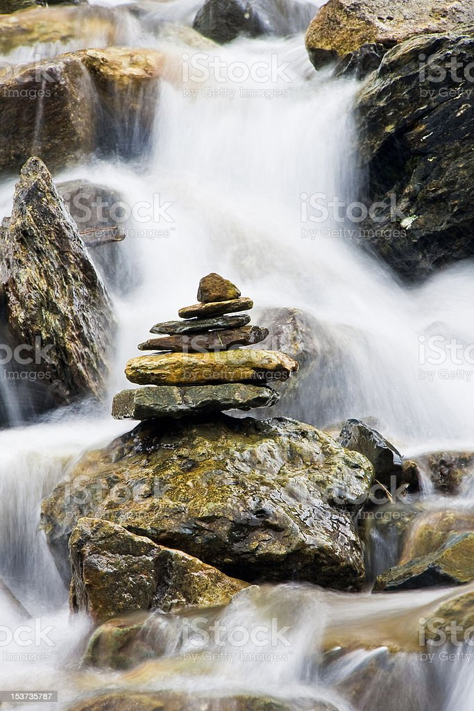 Tower of stones in waterfall stock photo