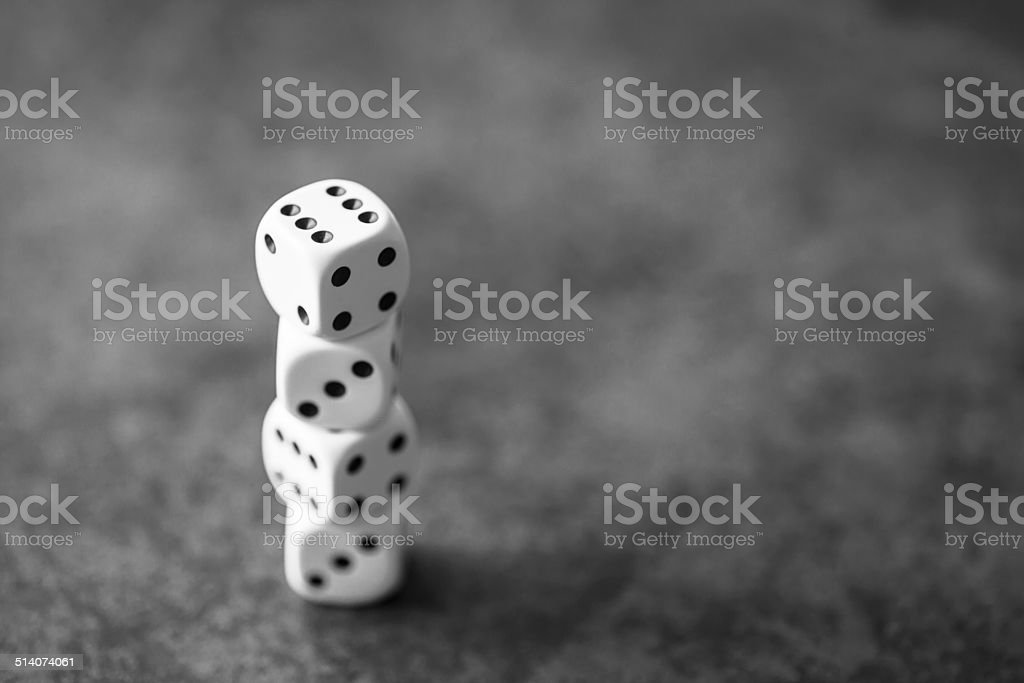 Tower of white dice on grey background stock photo