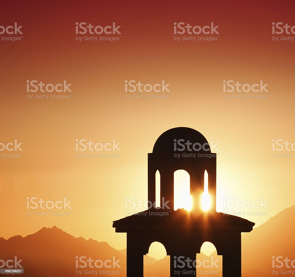 Tower silhouette in the beautiful sunset stock photo