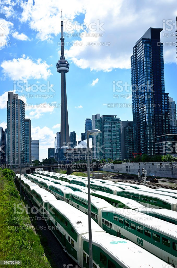 CN Tower taken from the West with parked commuter trains royalty-free stock photo