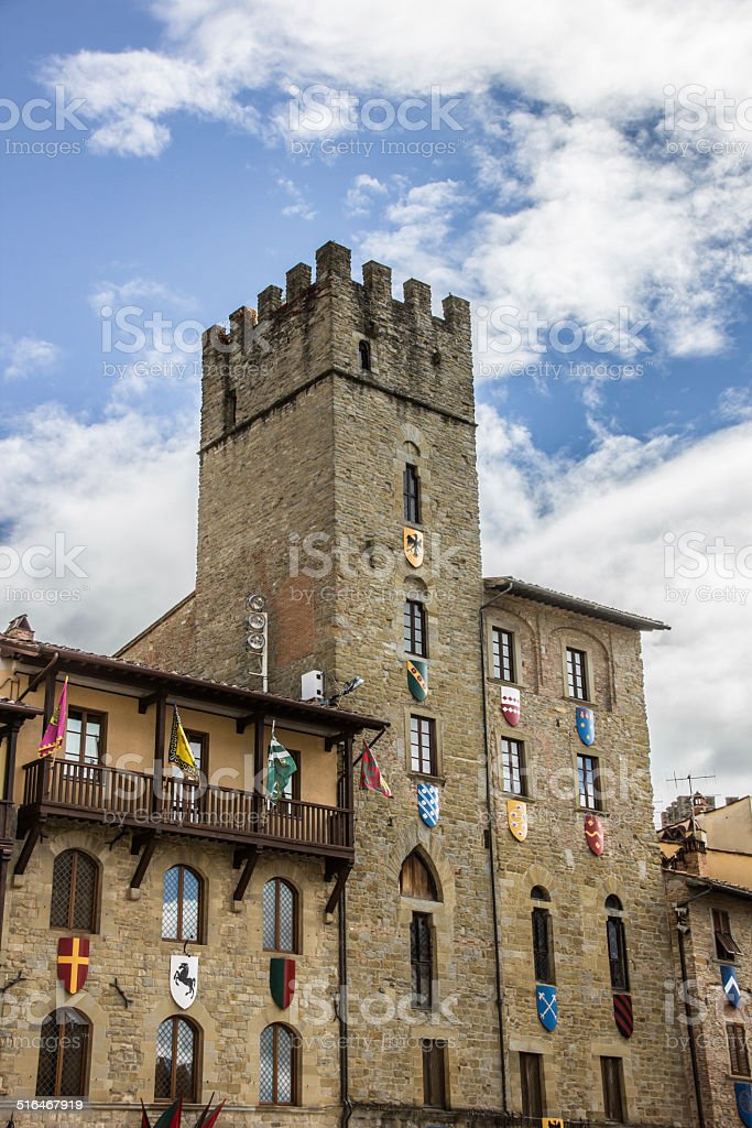 Tower with flags and shields at the Piazza Grande, Arezzo stock photo