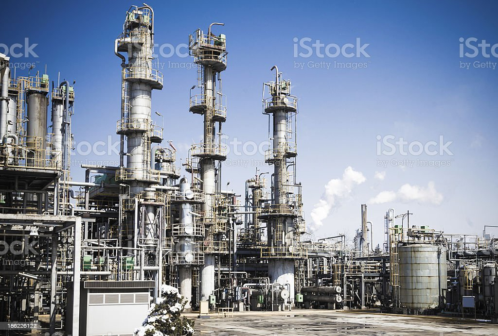 Towering chemical plant set over a blue sky stock photo