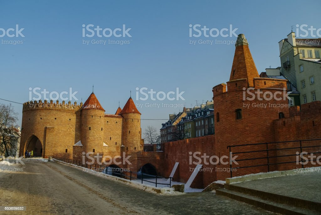 Towers and red brick walls of the historical Warsaw Barbican fortress, Poland stock photo