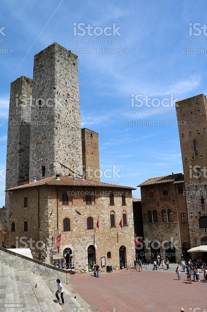 Towers at Piazza del Duomo in San Gimignano, Tuscany Italy stock photo