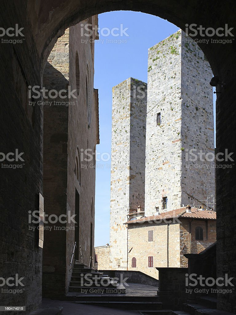 Towers in the piazza Duomo medieval town San Gimignano royalty-free stock photo