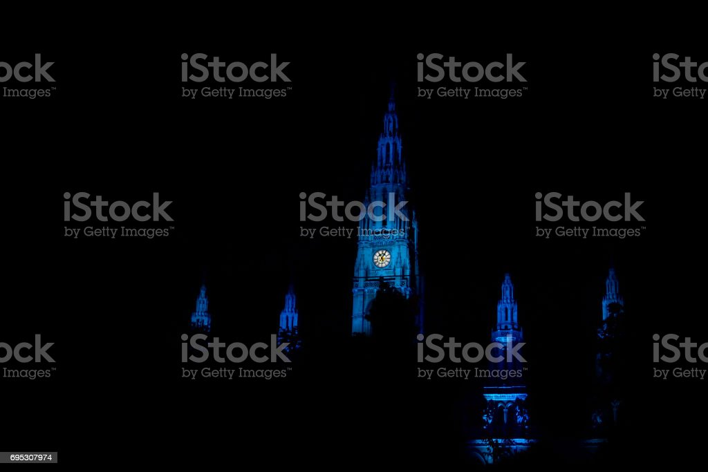 Towers of city hall in Vienna iluminated during the Life Ball show stock photo