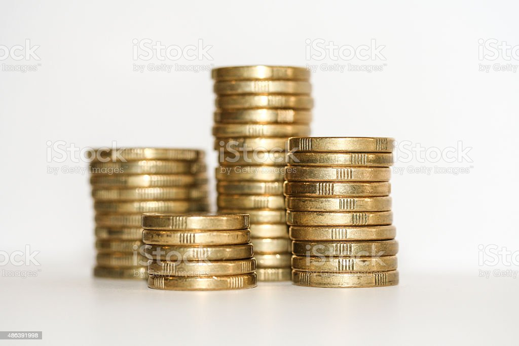 Towers of gold one and two dollar coins. stock photo